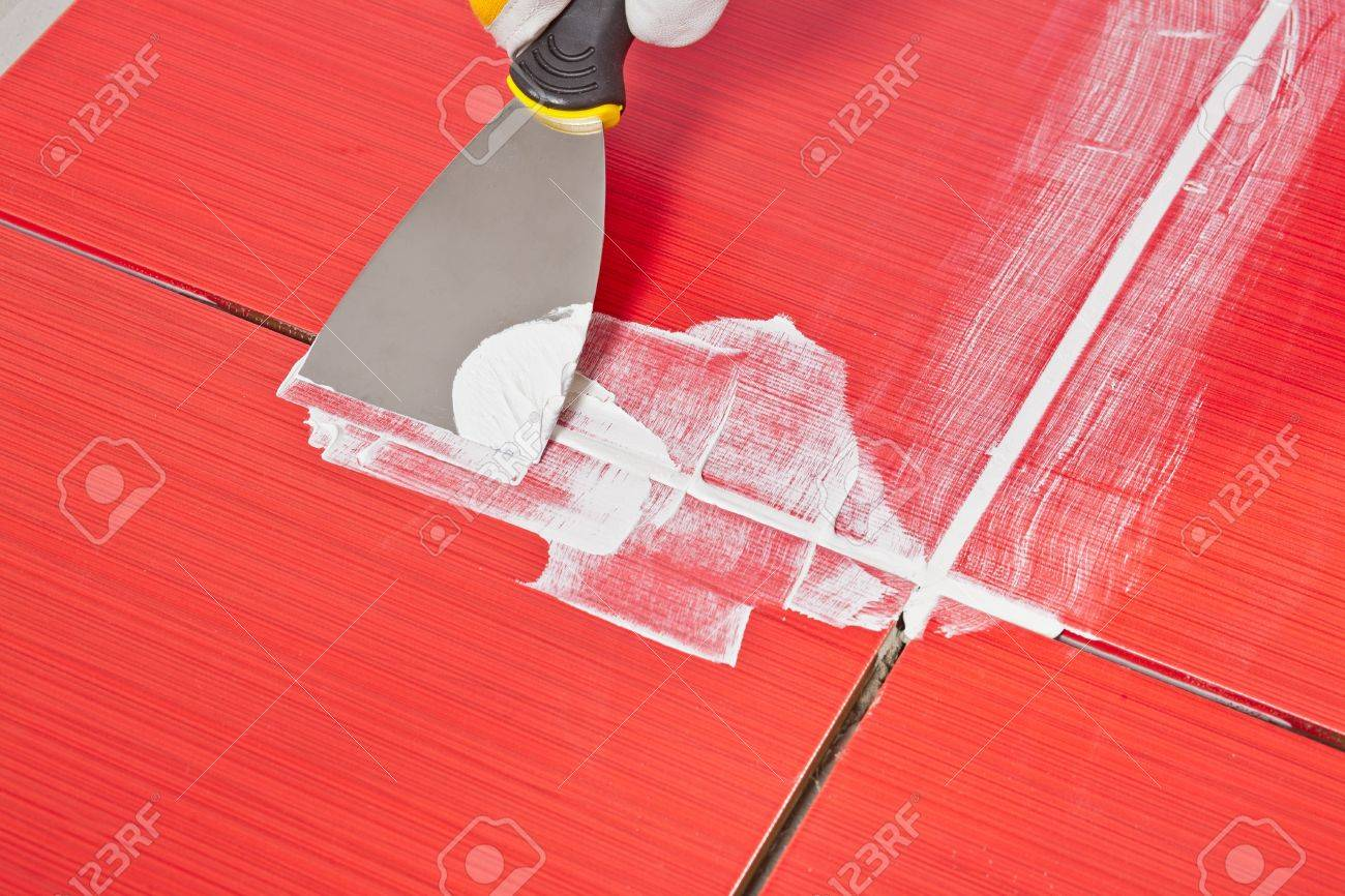 Steel pallet fill up joints between ceramic tiles whit grout stock steel pallet fill up joints between ceramic tiles whit grout stock photo 14669928 dailygadgetfo Choice Image