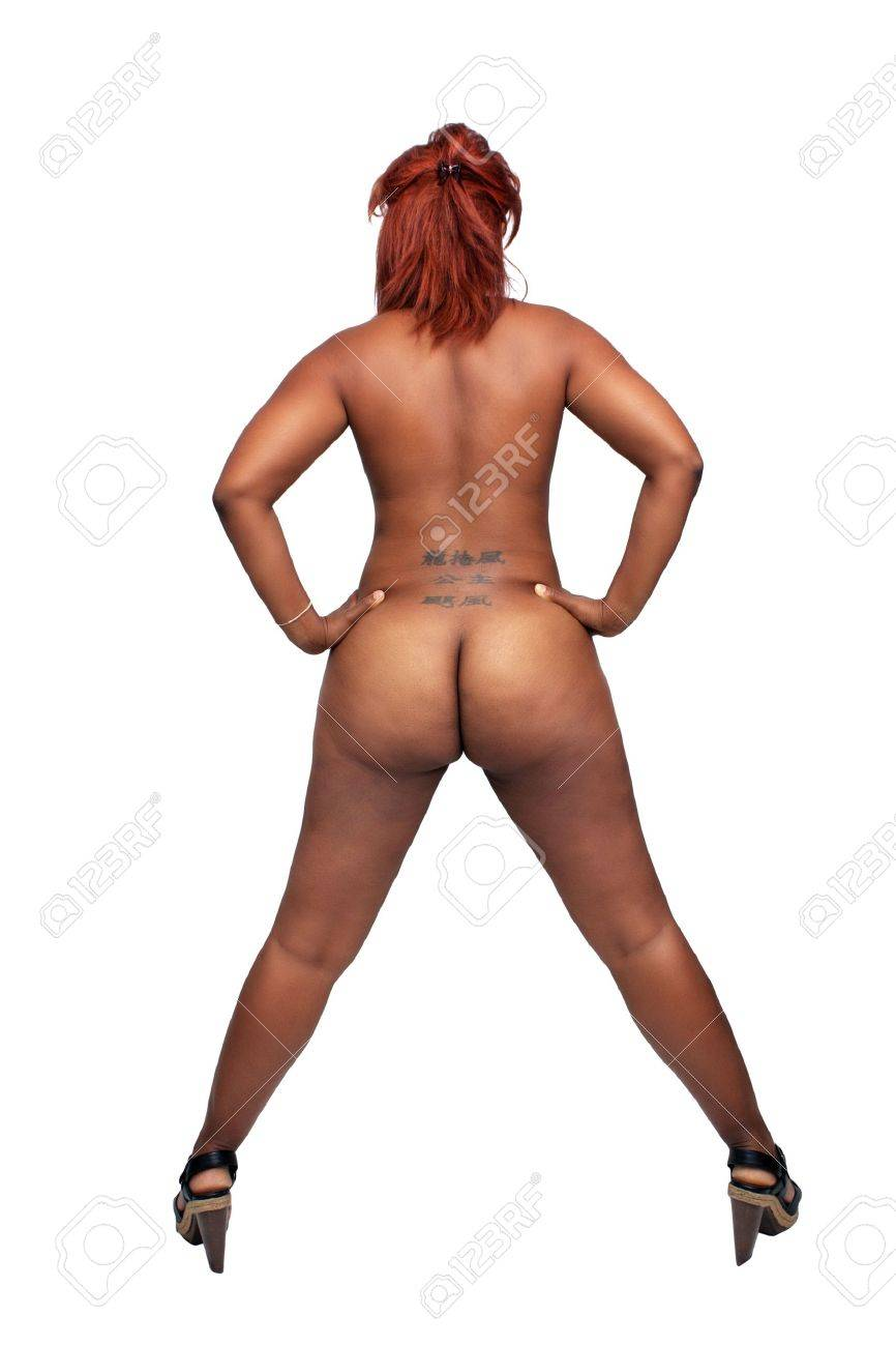 A full-length shot of a lovely young nude black woman with red hair, isolated on a white background with generous copyspace Stock Photo - 14663872