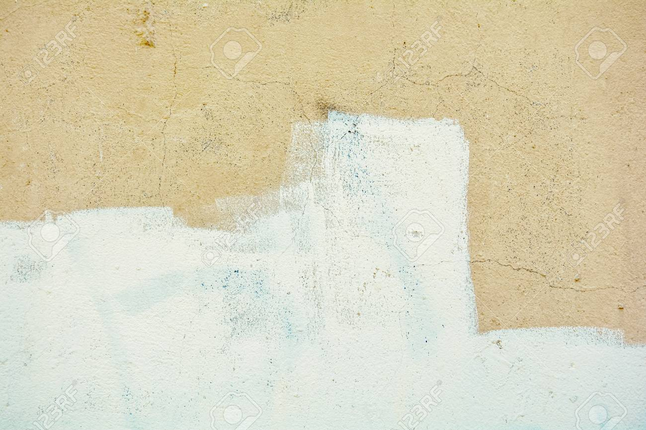 Yellow Rough Concrete Wall With A Cracks And A White Paint Stock ...