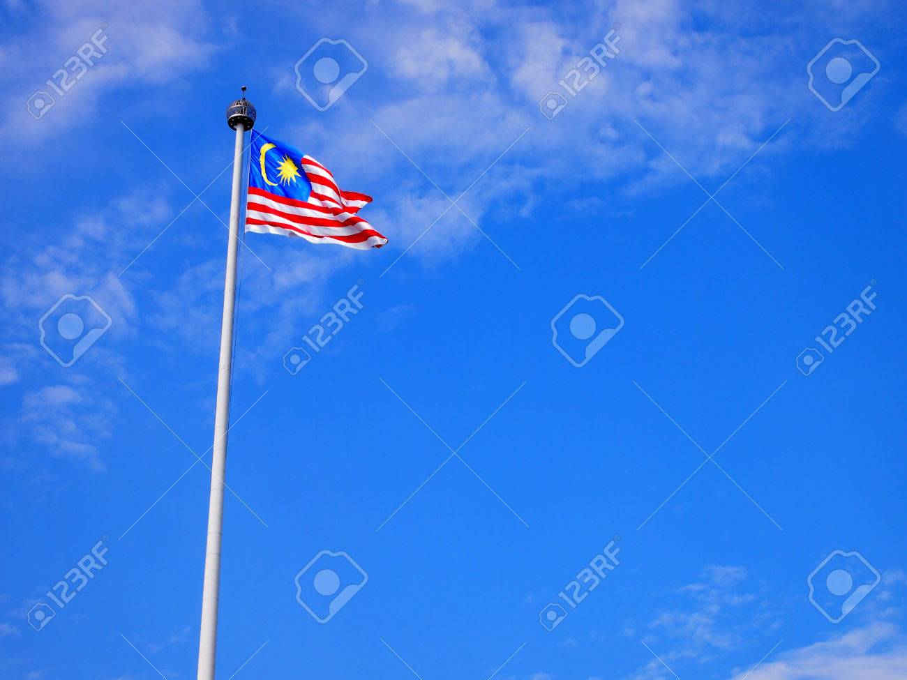 Malaysia flag waving on the wind with blue sky - 40886818