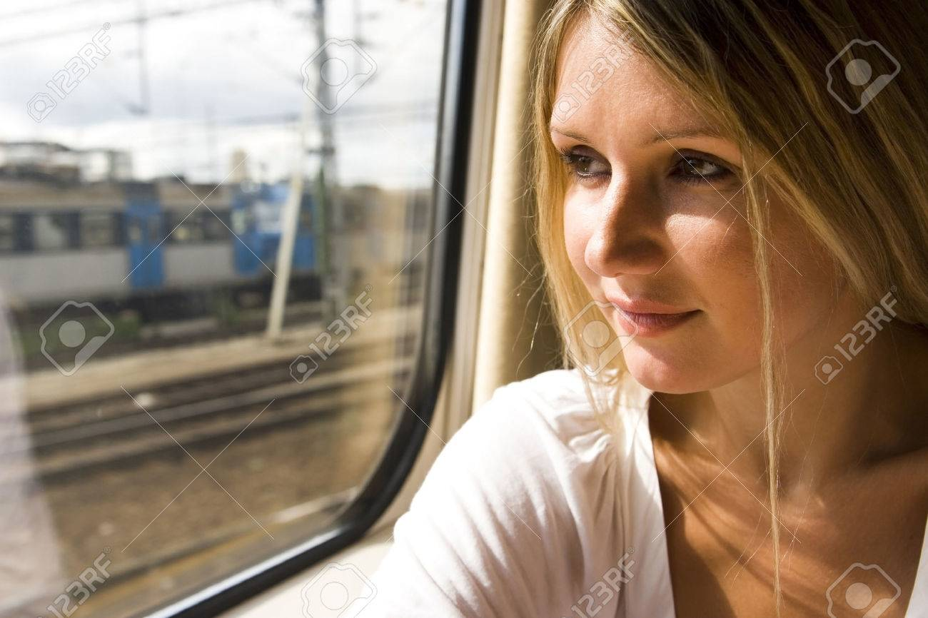 beautiful young woman in vintage train - 1379865