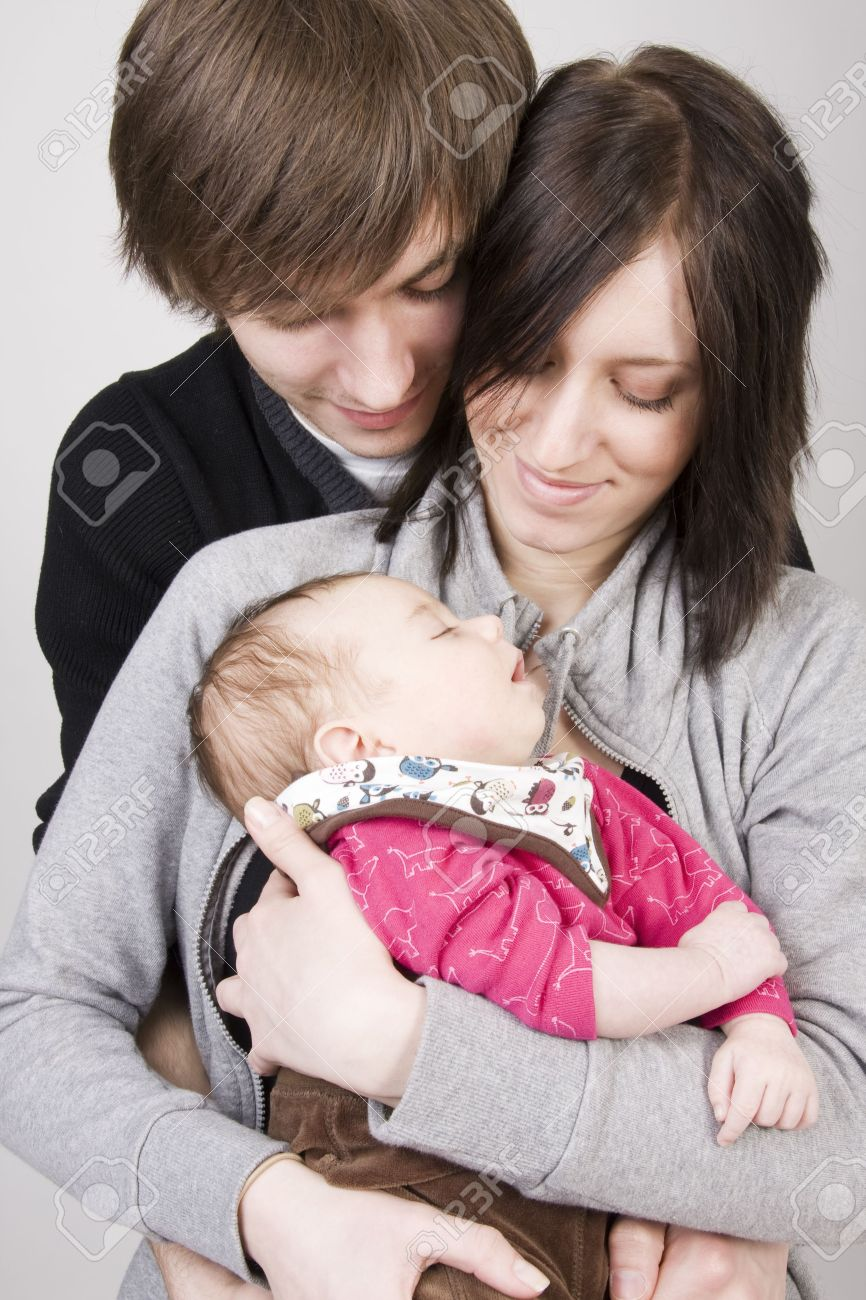 happy young family (father, mother and cute little baby girl) stock