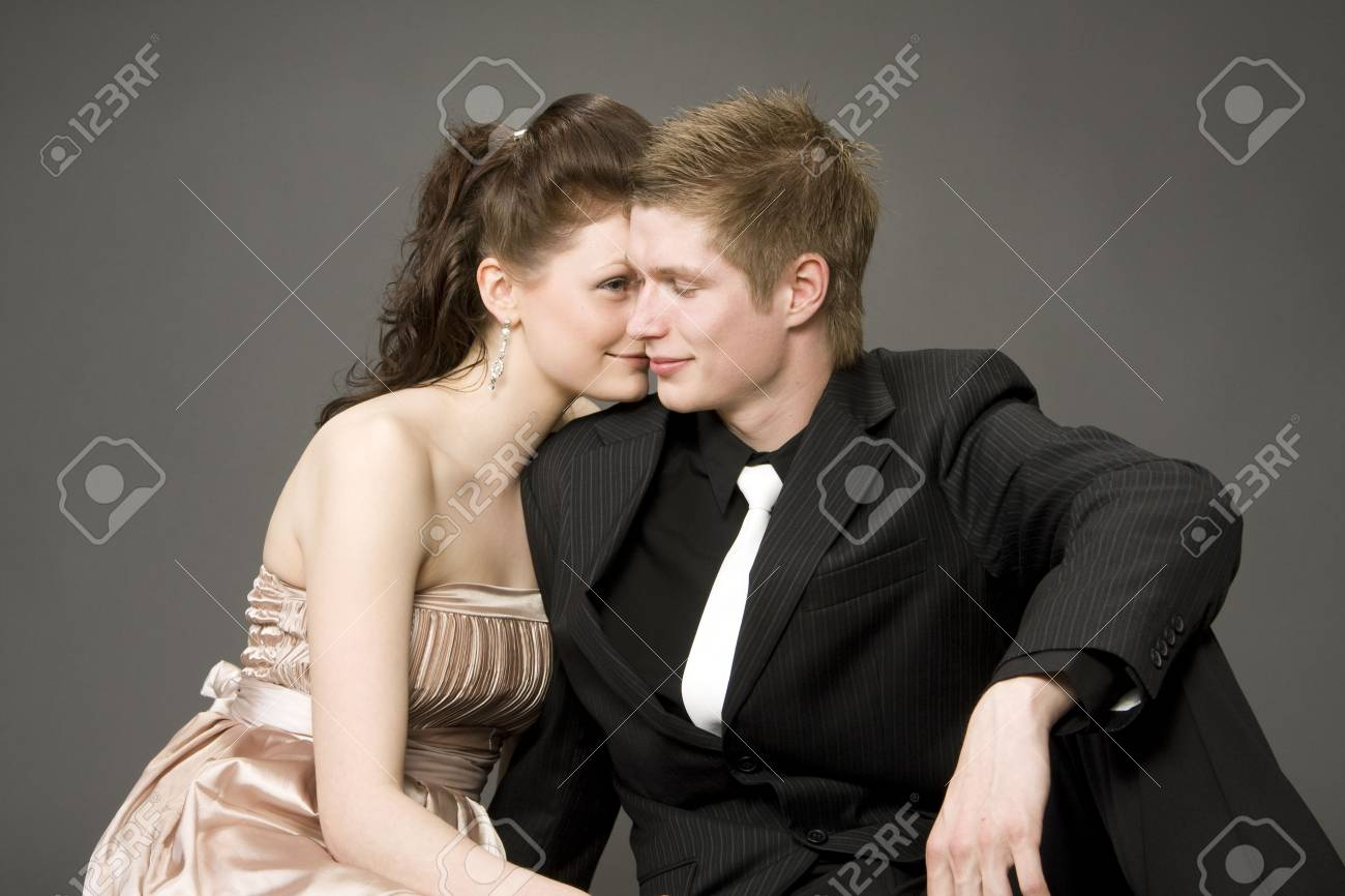 Portrait of a young beautiful couple on gray background Stock Photo - 3263268