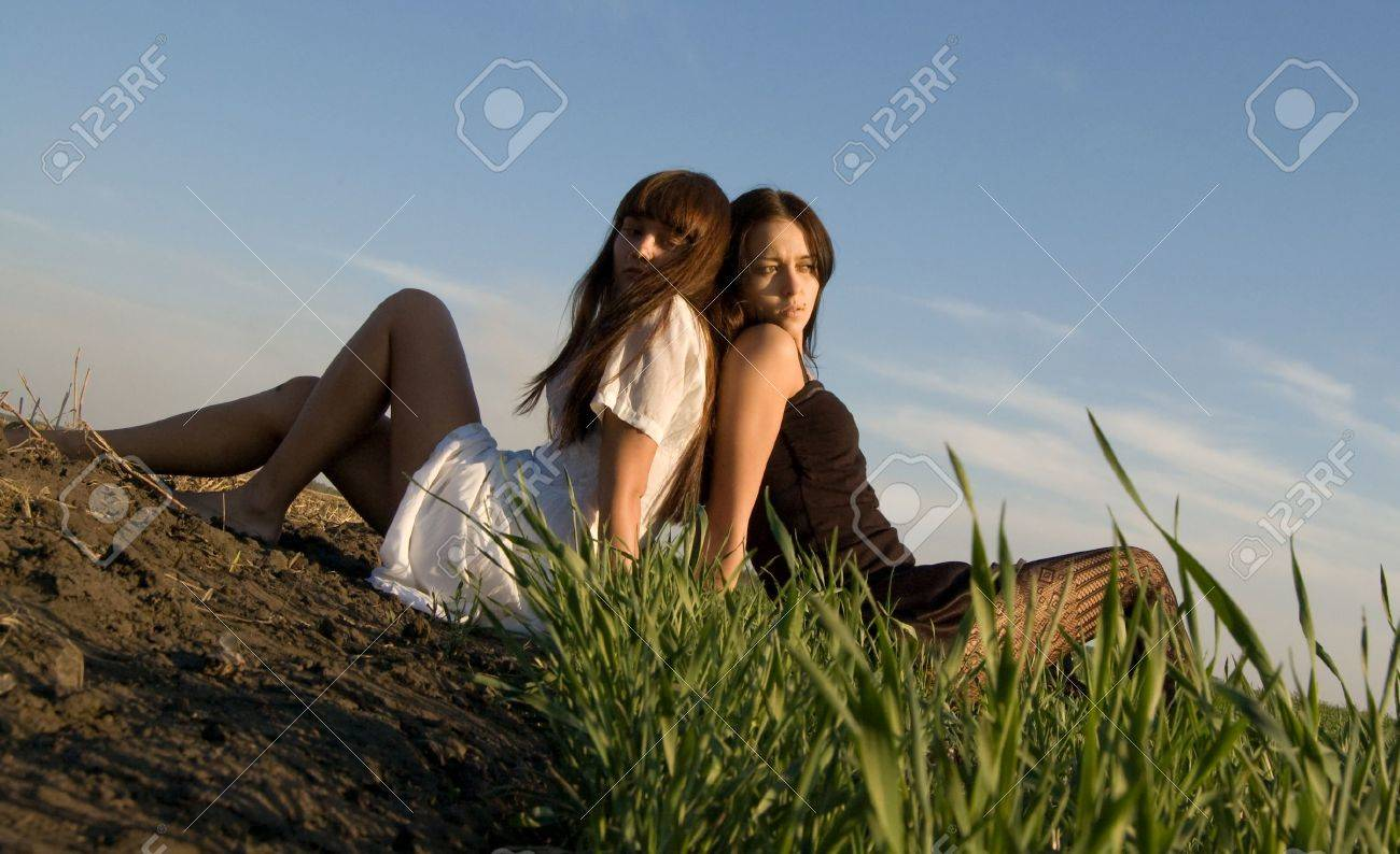 Two beautiful girls on the green grass Stock Photo - 3788933