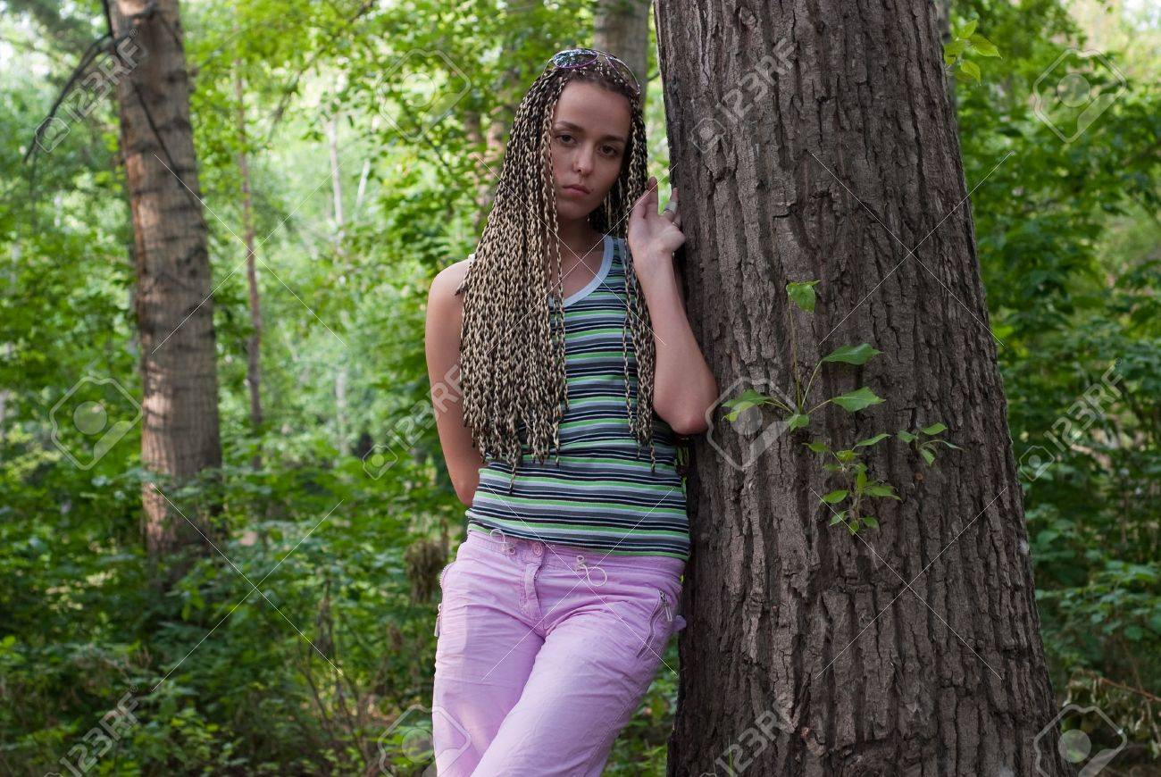 beauty girl beside poplar tree on the forest background Stock Photo - 5319384
