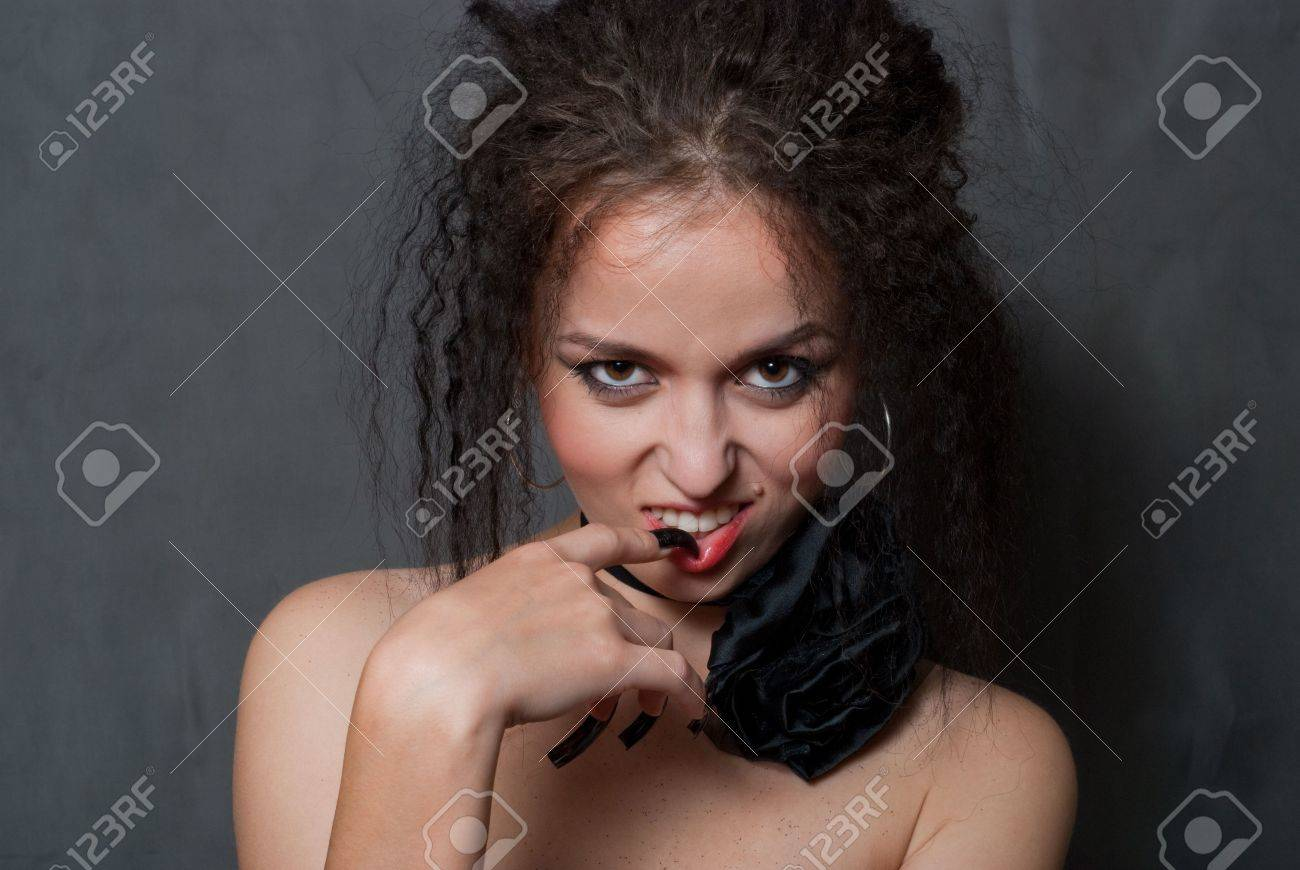 beauty young witch with black nails smilling on gray background Stock Photo - 5580642