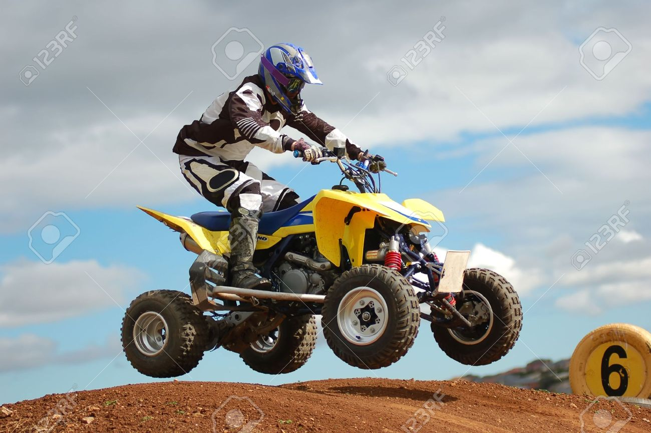 Quad bike racing, Airborne over a jump Stock Photo - 2354967