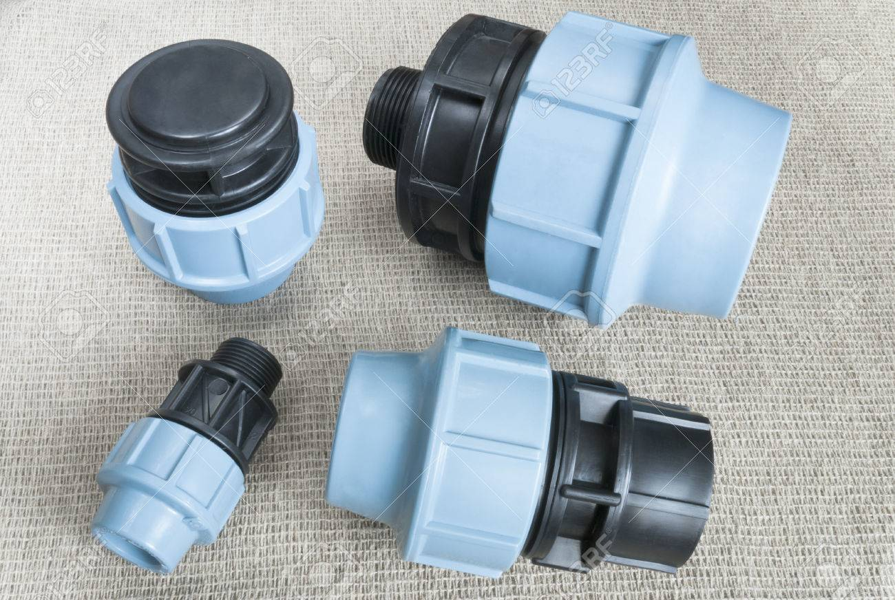 compression couplings and fittings for polyethylene pipes Stock Photo - 41883733 & Compression Couplings And Fittings For Polyethylene Pipes Stock ...