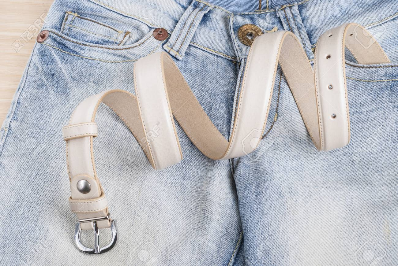 women's jeans on the table and collapsed belt - 44238563