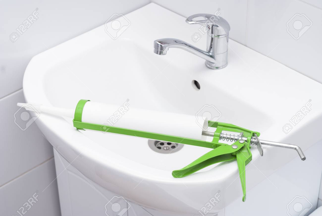 Sanitary Silicone Sealant Against The Background Of A Sink In - Bathroom sink sealant