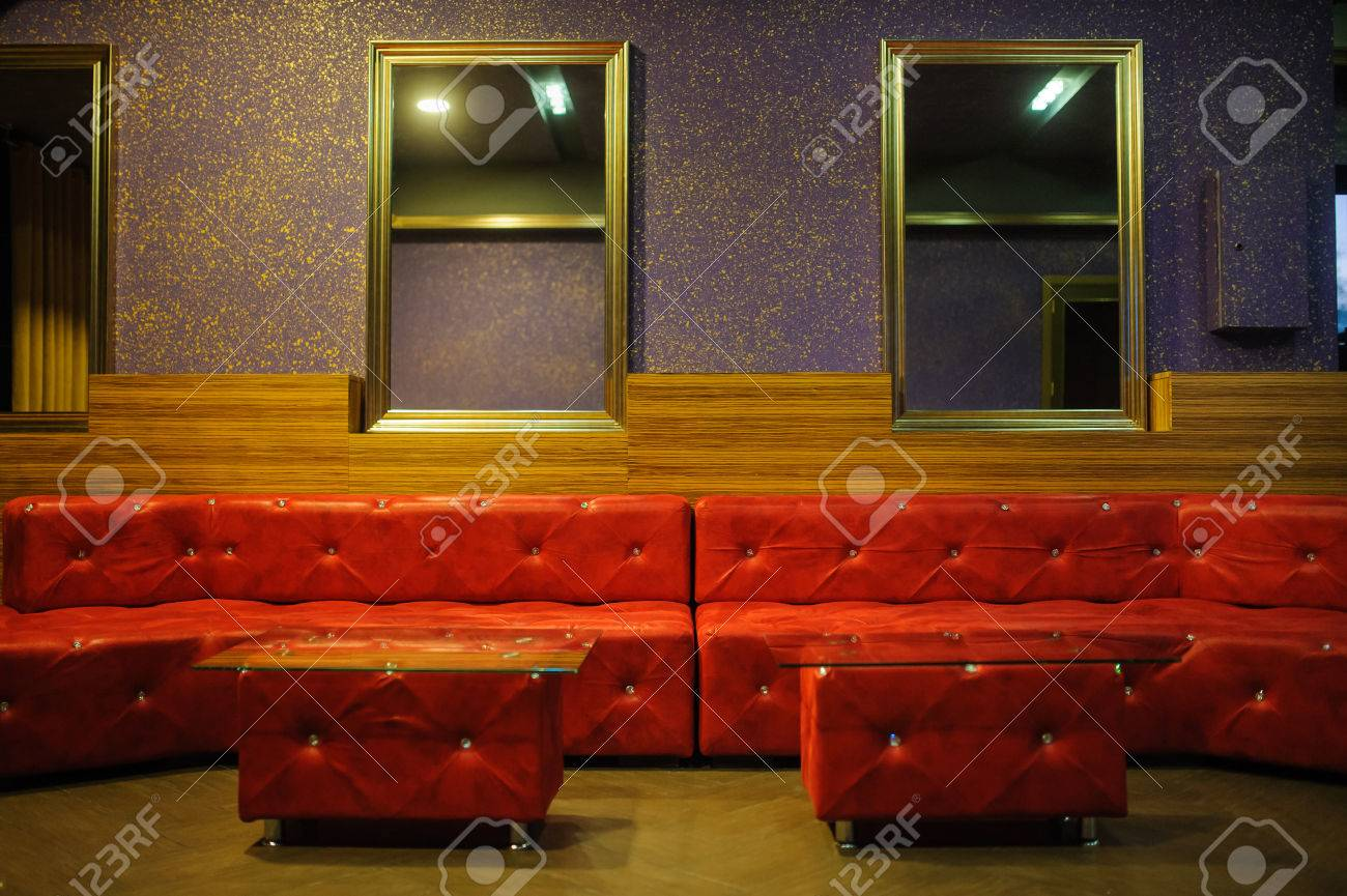 Stock Photo   Vintage Iterior With Red Leather Sofa , Mirrors And Gold  Purple Wall