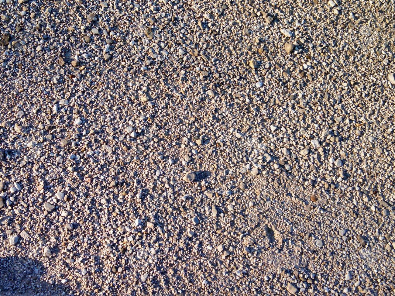 Different sizes of gravel in a parking