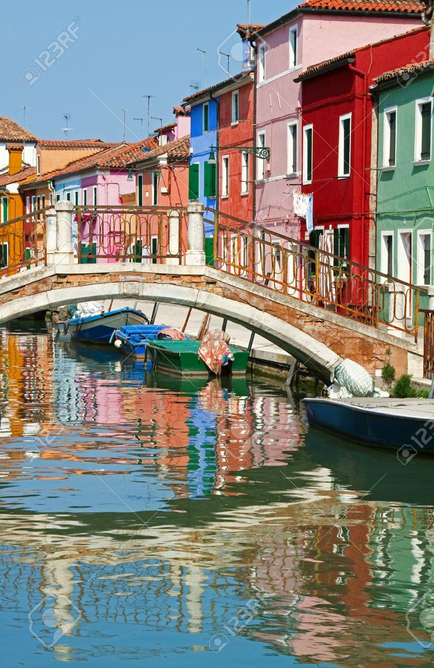 Bridge and colourful houses in a sunny Burano. Stock Photo - 18406097