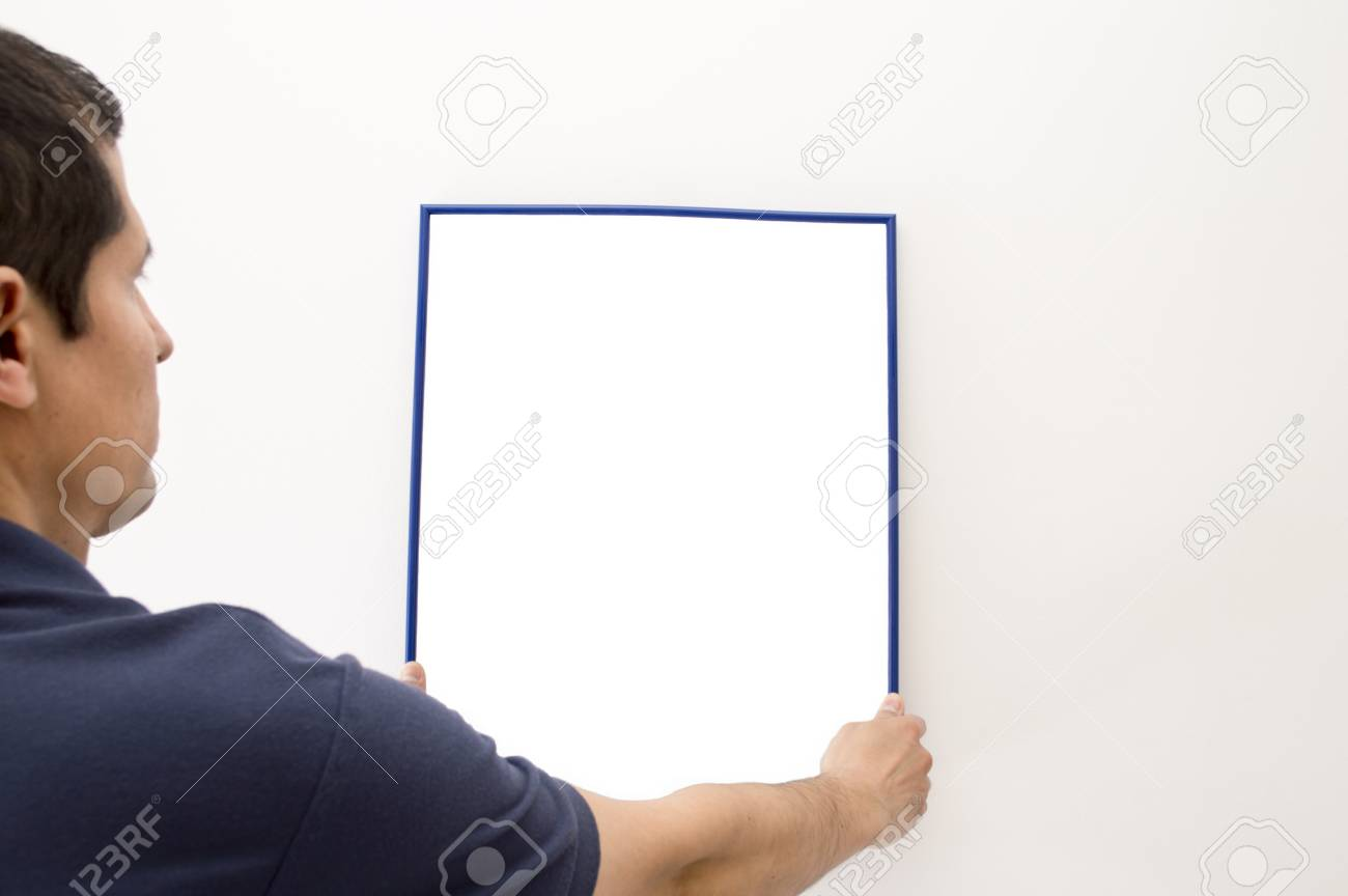 man putting a picture on the wall Stock Photo - 18939815