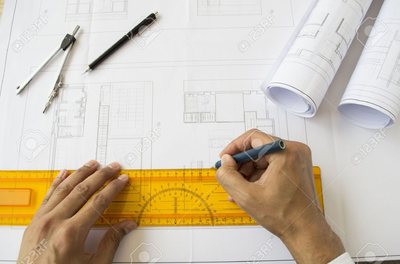 Gentil Architect Designing A Plan Of A House Stock Photo   20785517