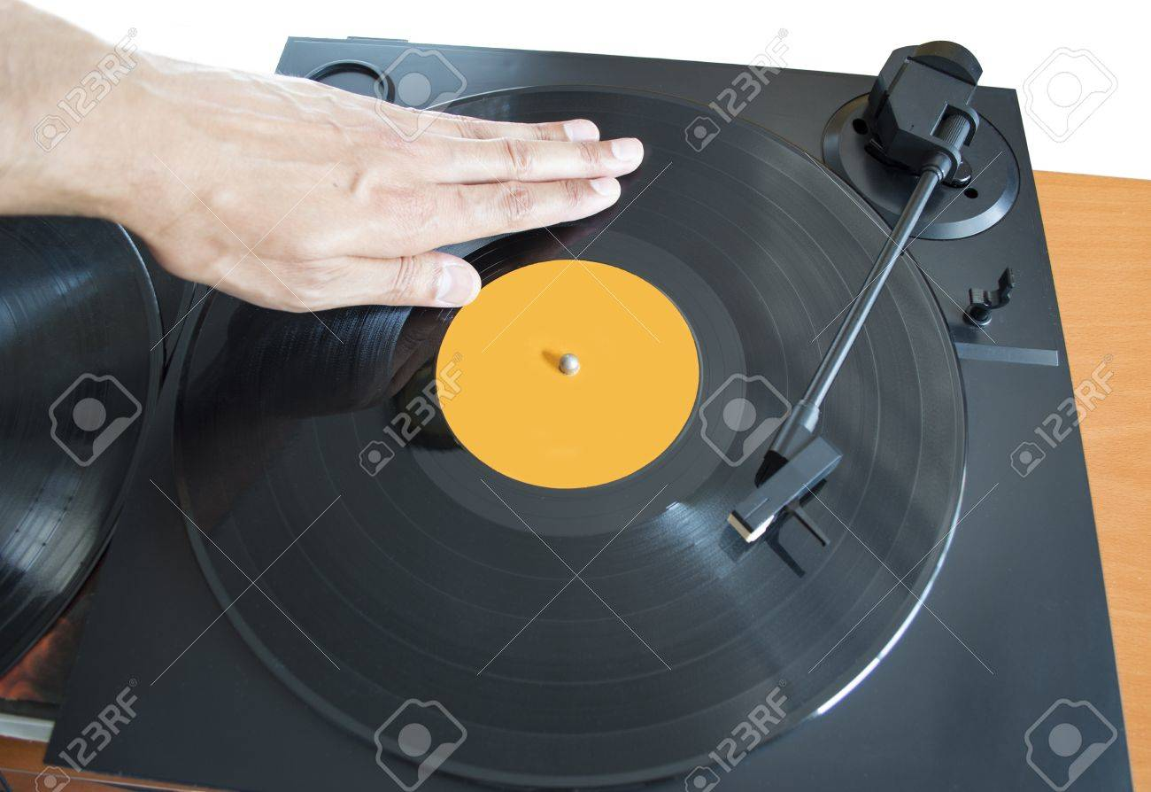 DJ mixing vinyl record on a  turntable with hand Stock Photo - 21059744