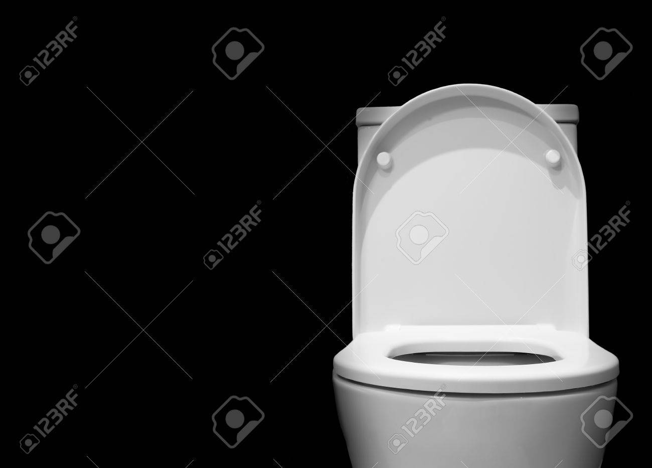 White Toilet With Black Seat. White toilet bowl in a bathroom with black background Stock Photo  43151190 Toilet Bowl In A Bathroom With Black Background