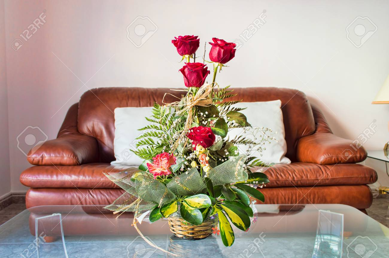 Astounding Vase Of Red Flowers In Modern Living Room With The Brown Leather Gmtry Best Dining Table And Chair Ideas Images Gmtryco