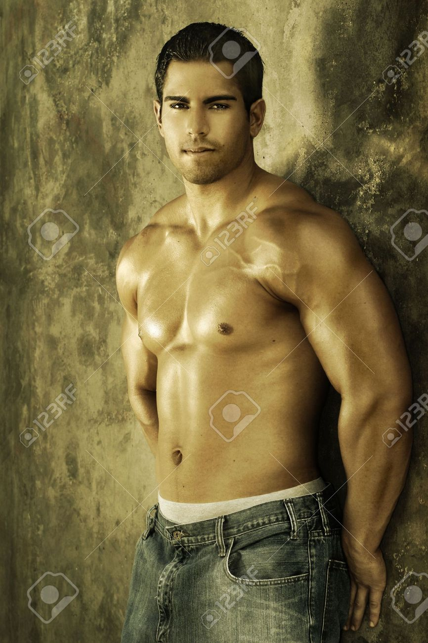 Young muscular male against wall with golden light Stock Photo - 3754635