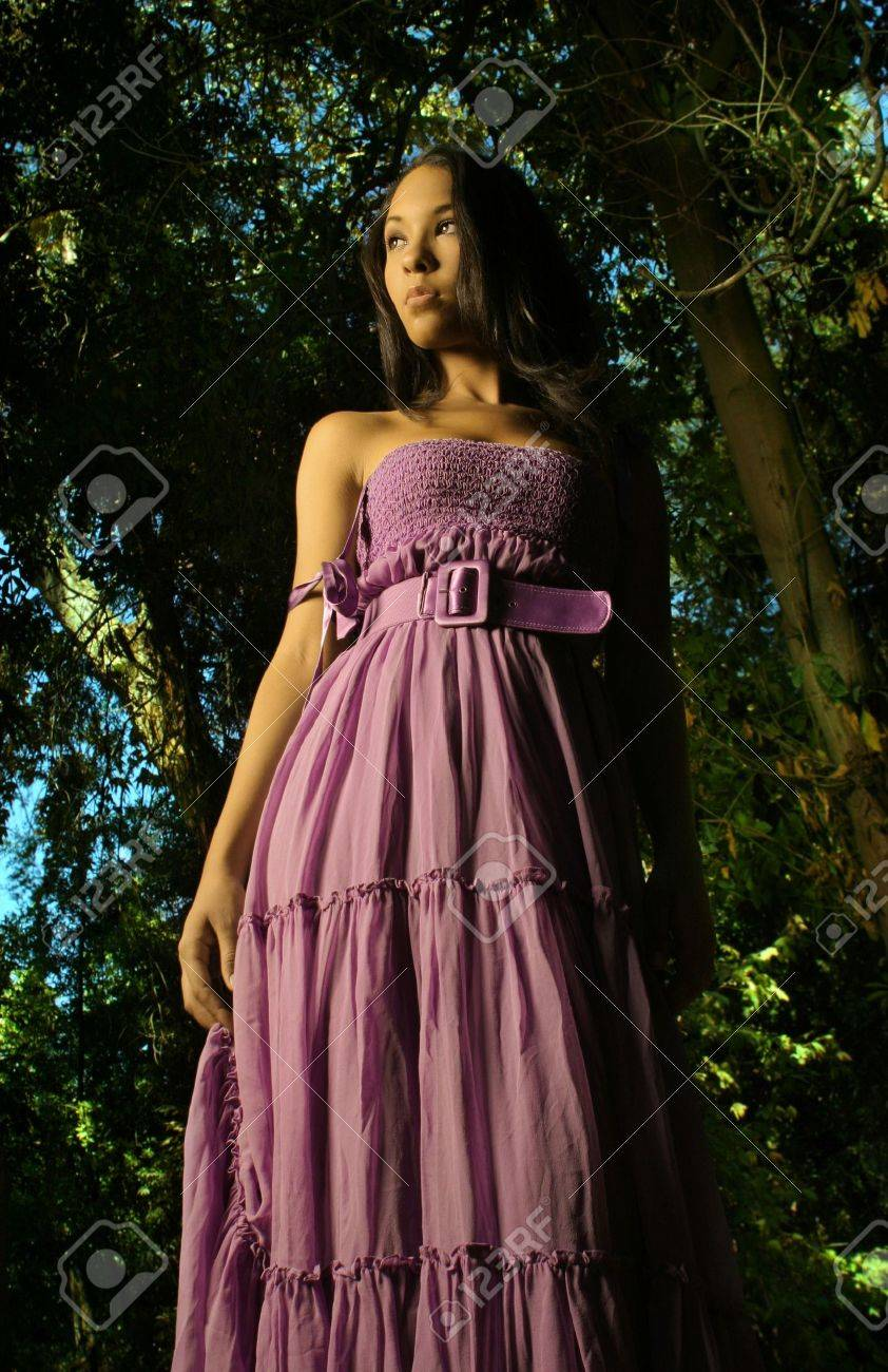 Dramatic fashion shot of female model in purple flowing dress Stock Photo -  3761025 c8e597cbc