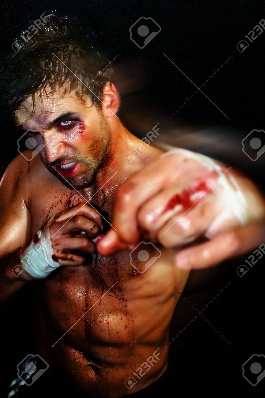 Gritty portrait of a sexy young, bloody boxer Stock Photo - 3829843