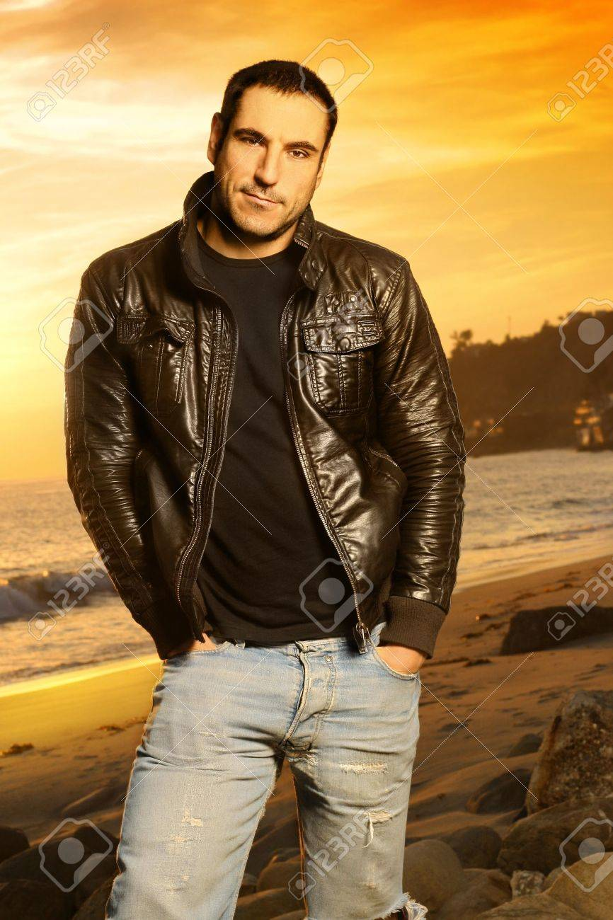 Full body portrait of good looking man in golden light wearing a leather jacket against beautiful sunset Stock Photo - 4131653