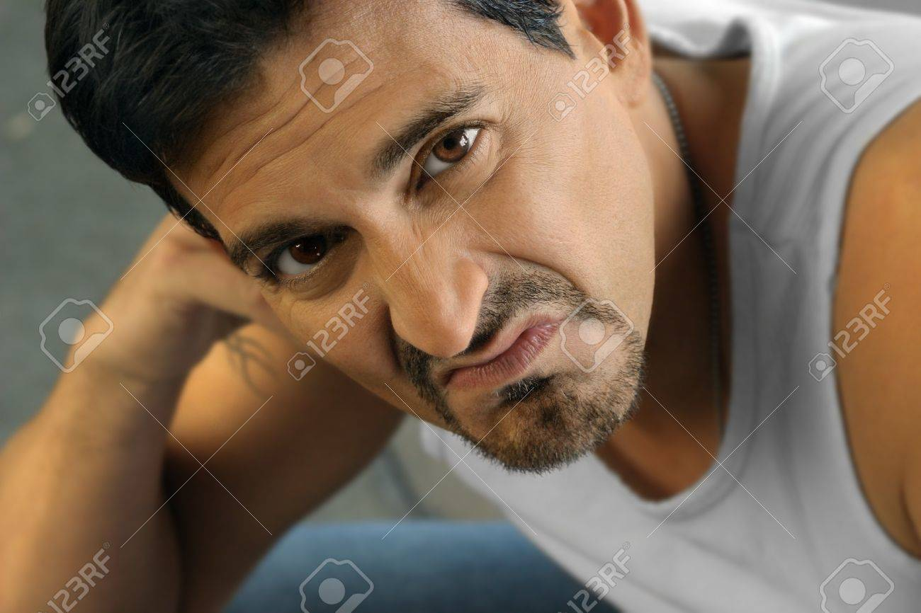 Tough looking man in white tank top expressing disgust Stock Photo - 4374056