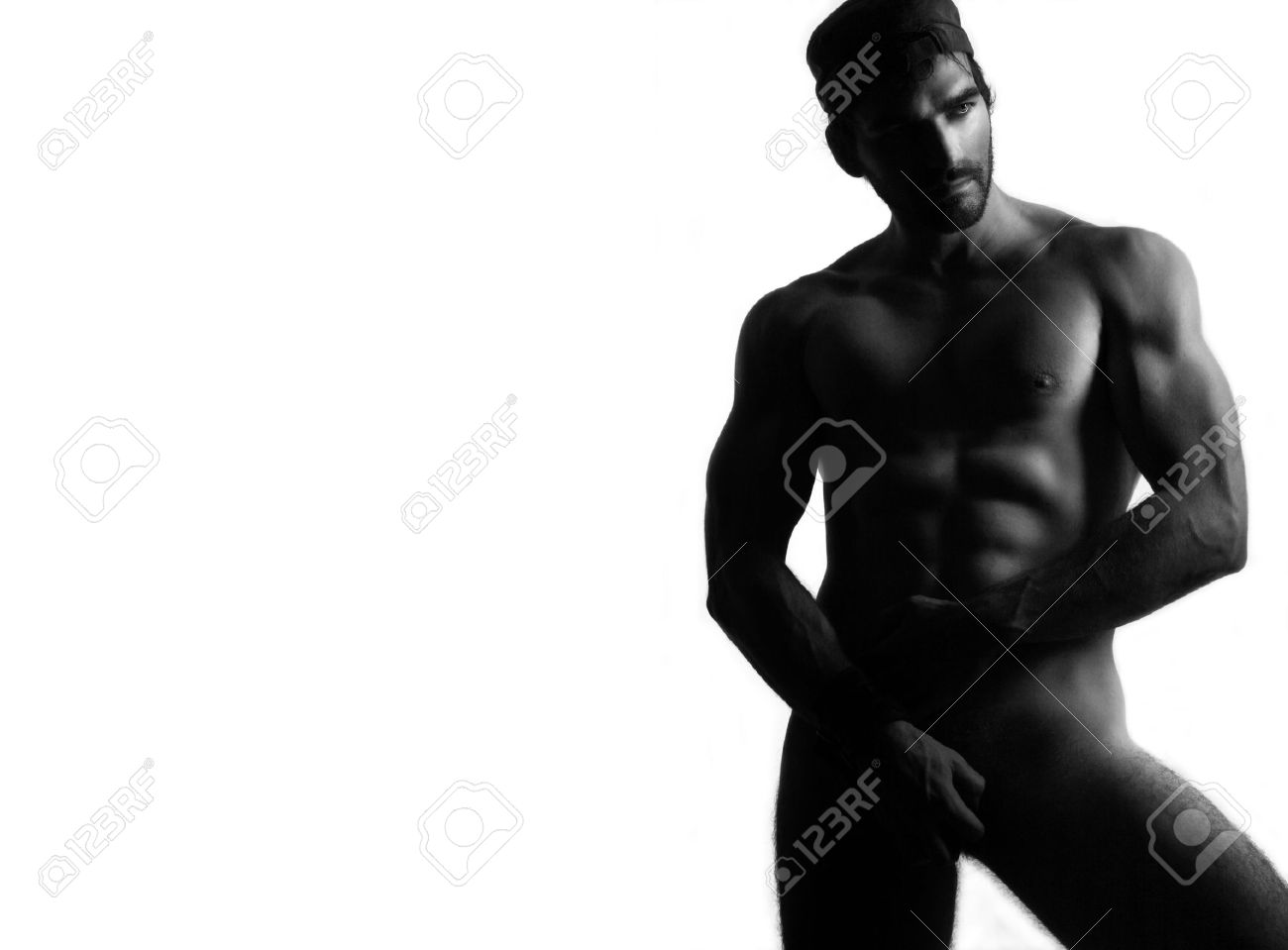 Full body black and white portrait of a sexy nude man against white background Stock Photo - 4634423