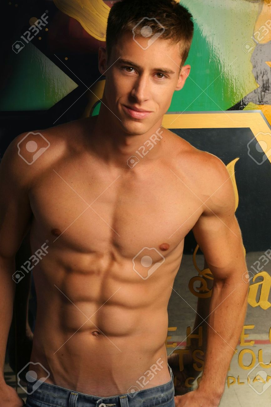Portrait of a shirtless muscular young man against abstract urban background Stock Photo - 4826908