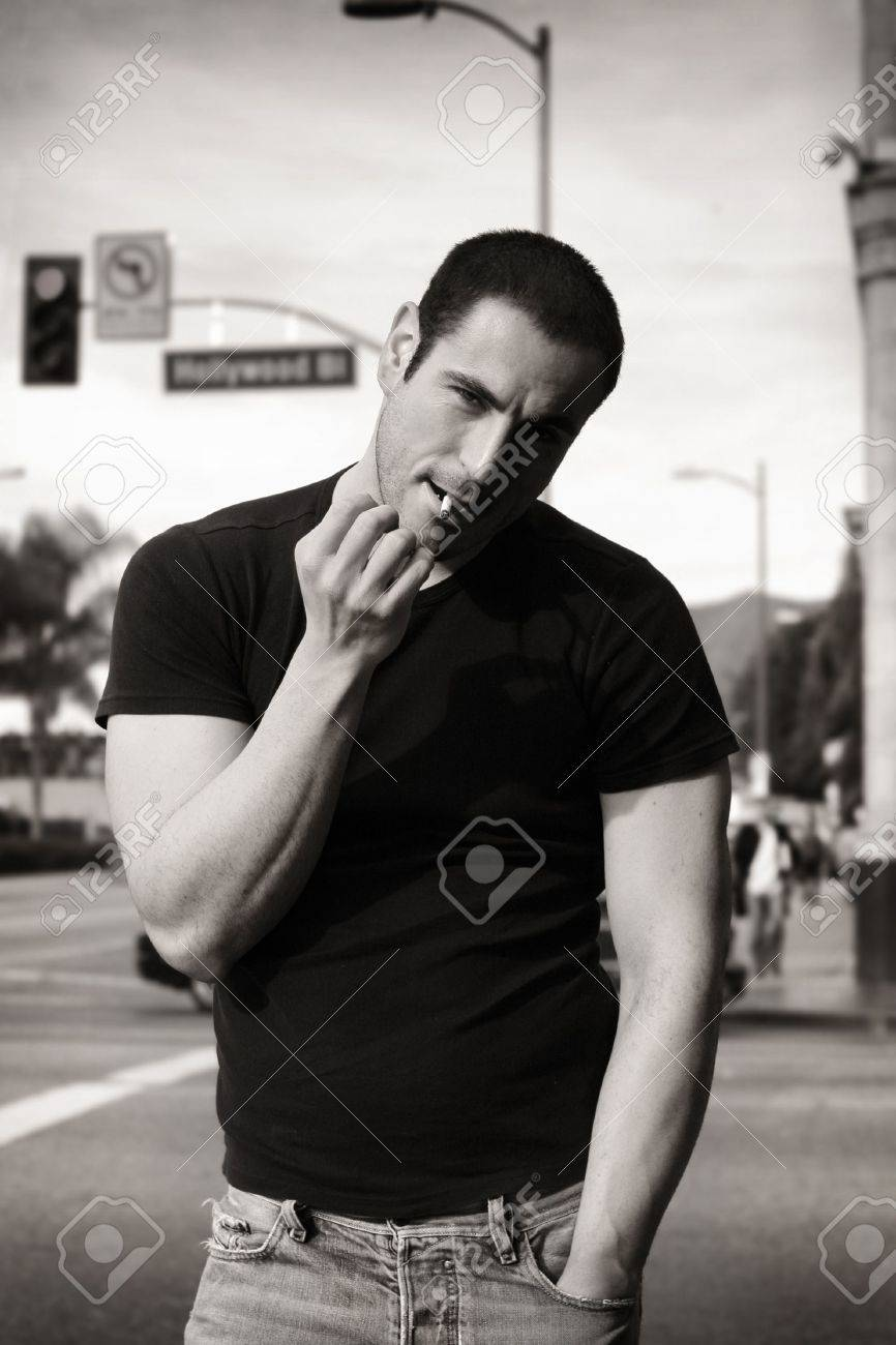 Classic black and white portrait of rugged good looking man smoking stock photo 5752241