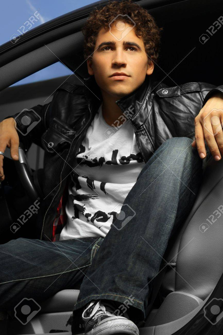 Hip young man in a car wearing leather jacket Stock Photo - 6412328