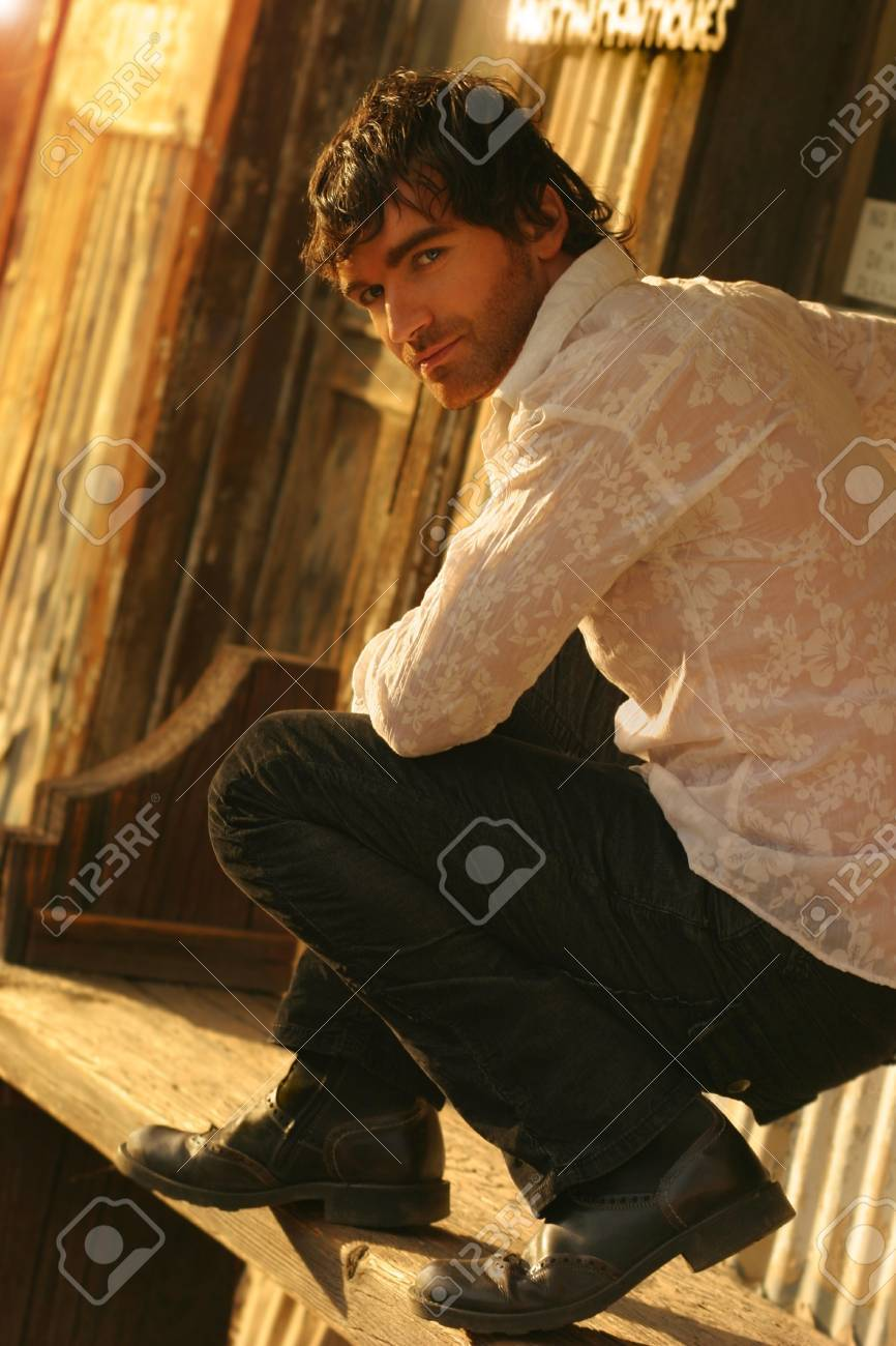 Young male model in golden sunlight turning back toward camera Stock Photo - 7497966