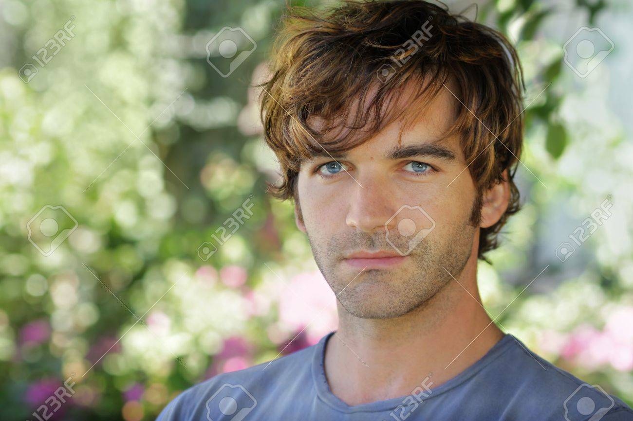 Close-up portrait of a beautiful young man against blurred garden background with lots of copy space Stock Photo - 7710697