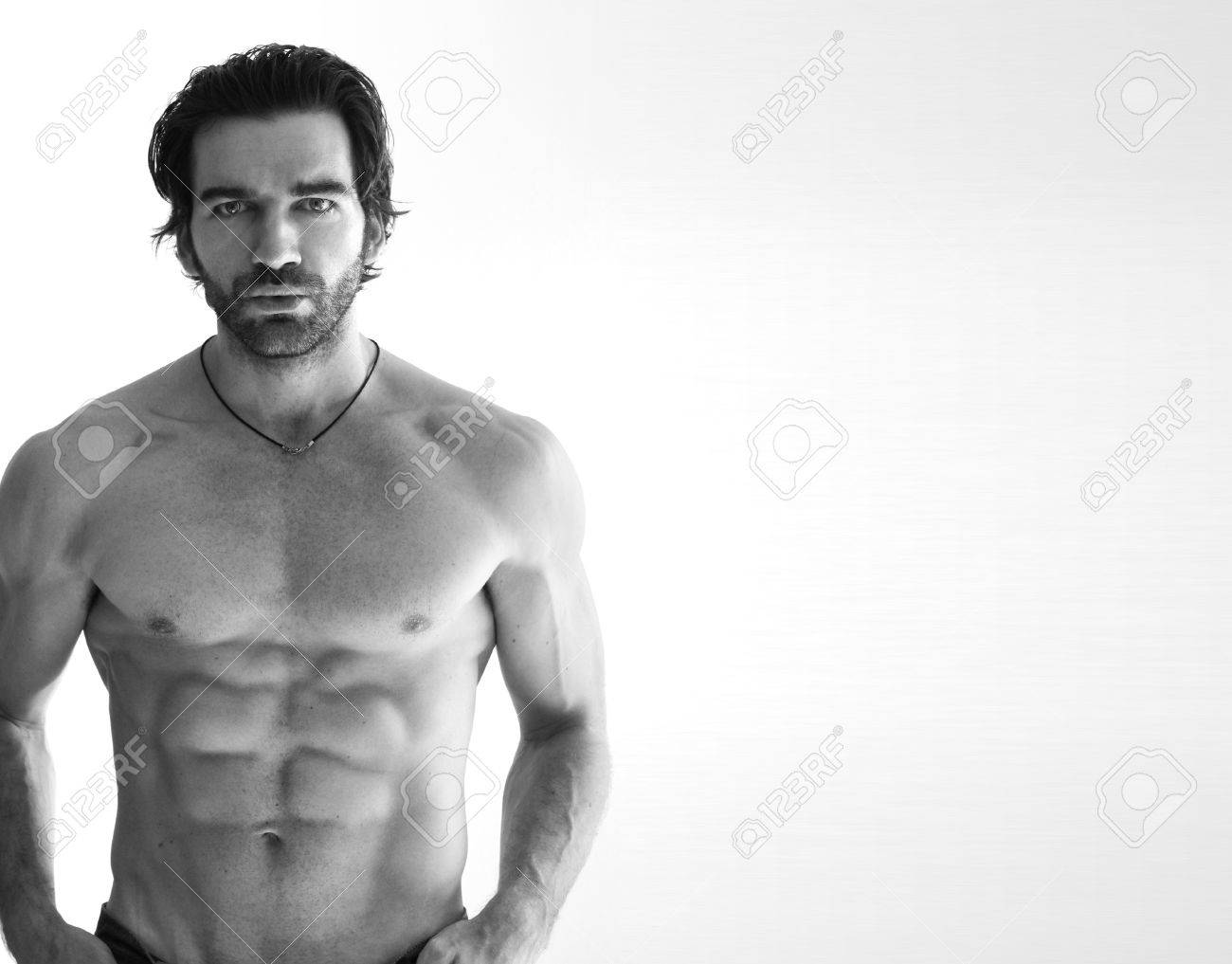 Sexy shirtless muscular man against white background Stock Photo - 8458588