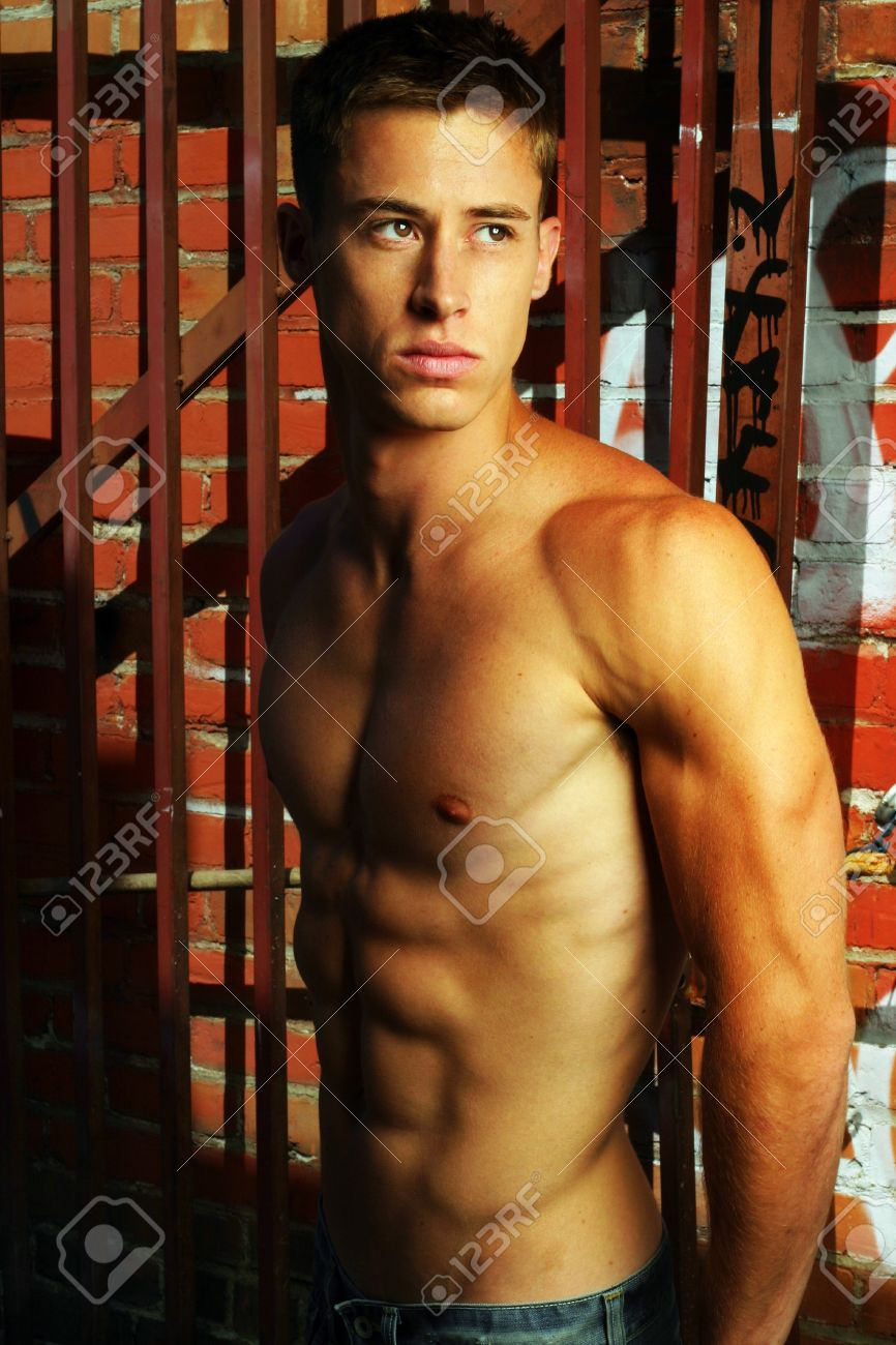 Sexy shirtless male model in street alley with graffiti Stock Photo - 8552184