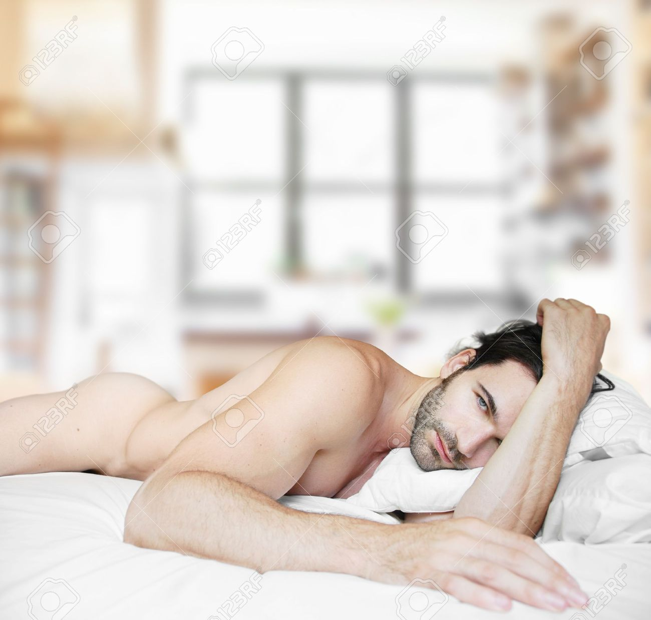 Sexy nude male model in bed at home alone Stock Photo - 10089969