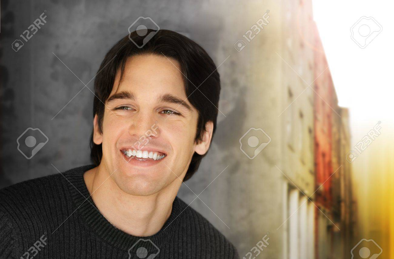 Portrait of a handsome young man with big smile against cool styled outdoor background Stock Photo - 10142149