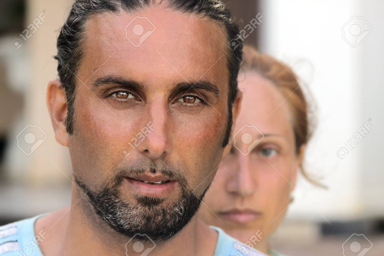 Close up portrait of a man with a woman behind him Stock Photo - 10893173