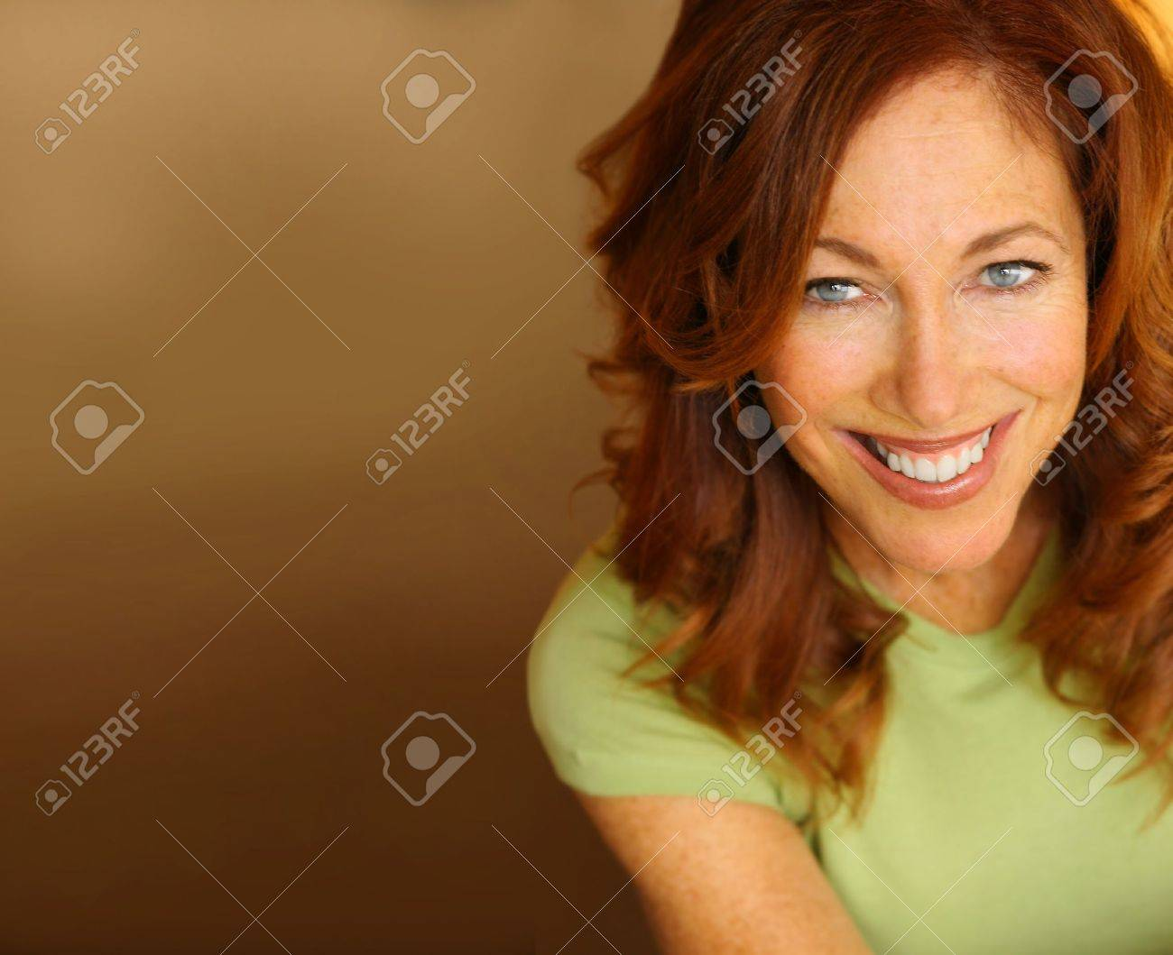 Portrait of a beautiful woman with big smile against neutral background - 10854670