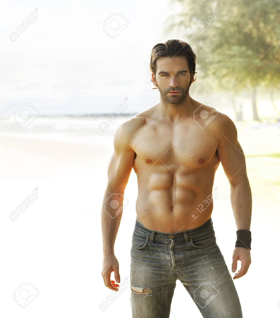 Portrait of a beautiful shirtless man in jeans relaxing outside Stock Photo - 11001286