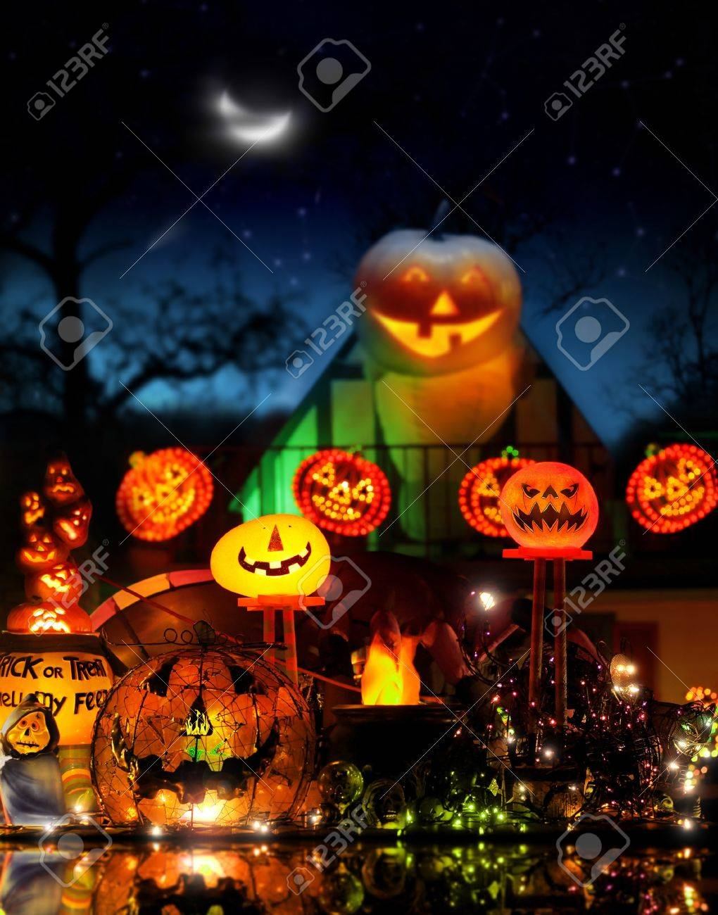 Happy Halloween image with lots of glowing jackolanterns in fantastical spooky environment Stock Photo - 11001311