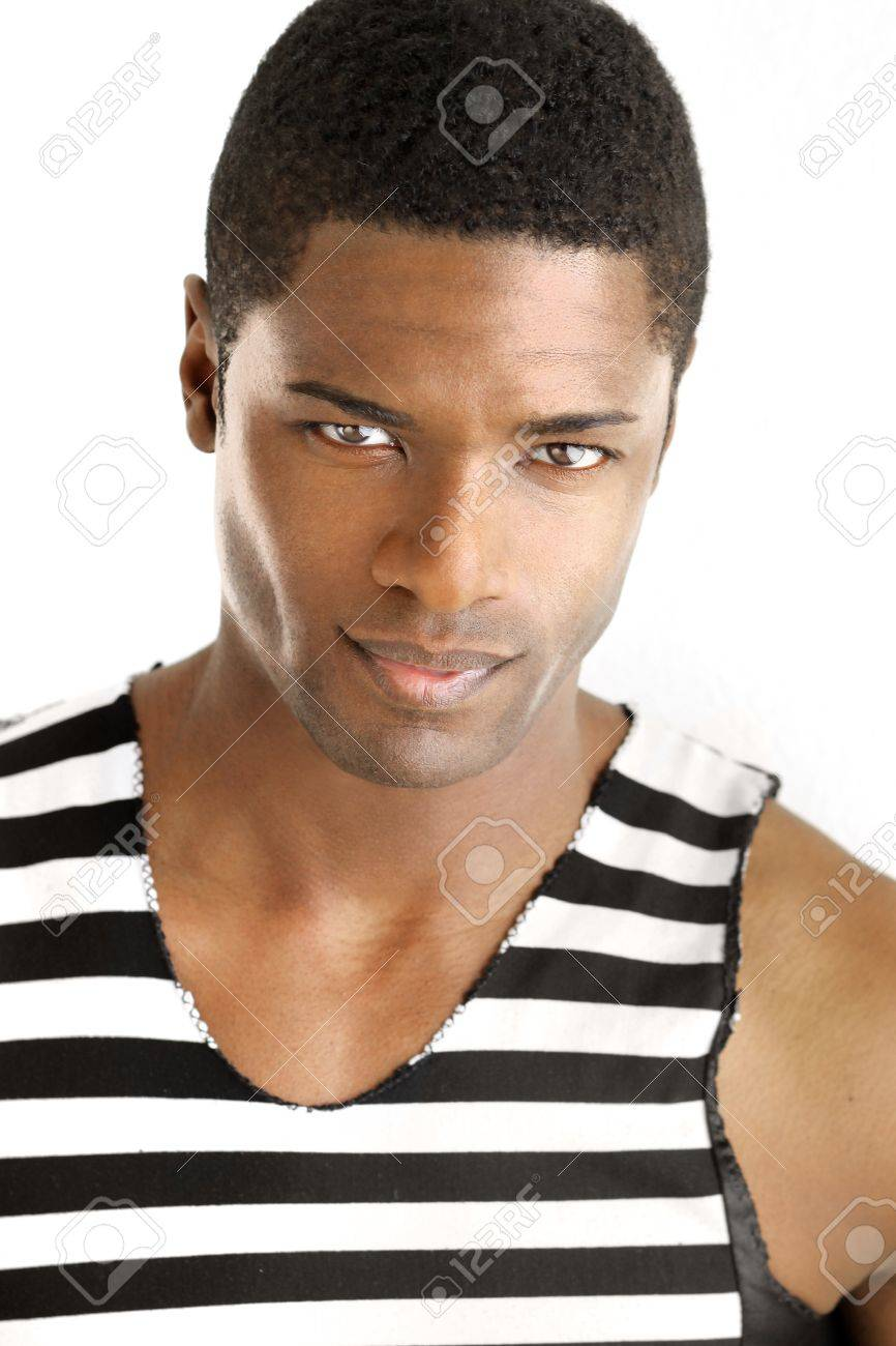 Detailed portrait of a young black man in trendy clothing against white background Stock Photo - 12479729