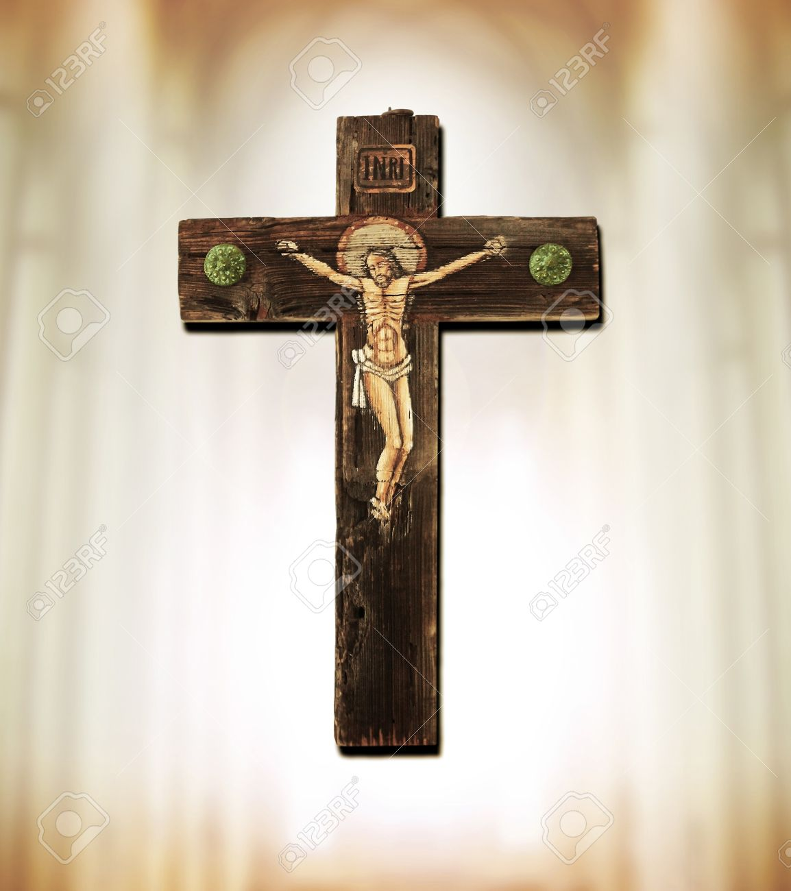 old wooden cross depicting crucifixion of jesus christ stock photo