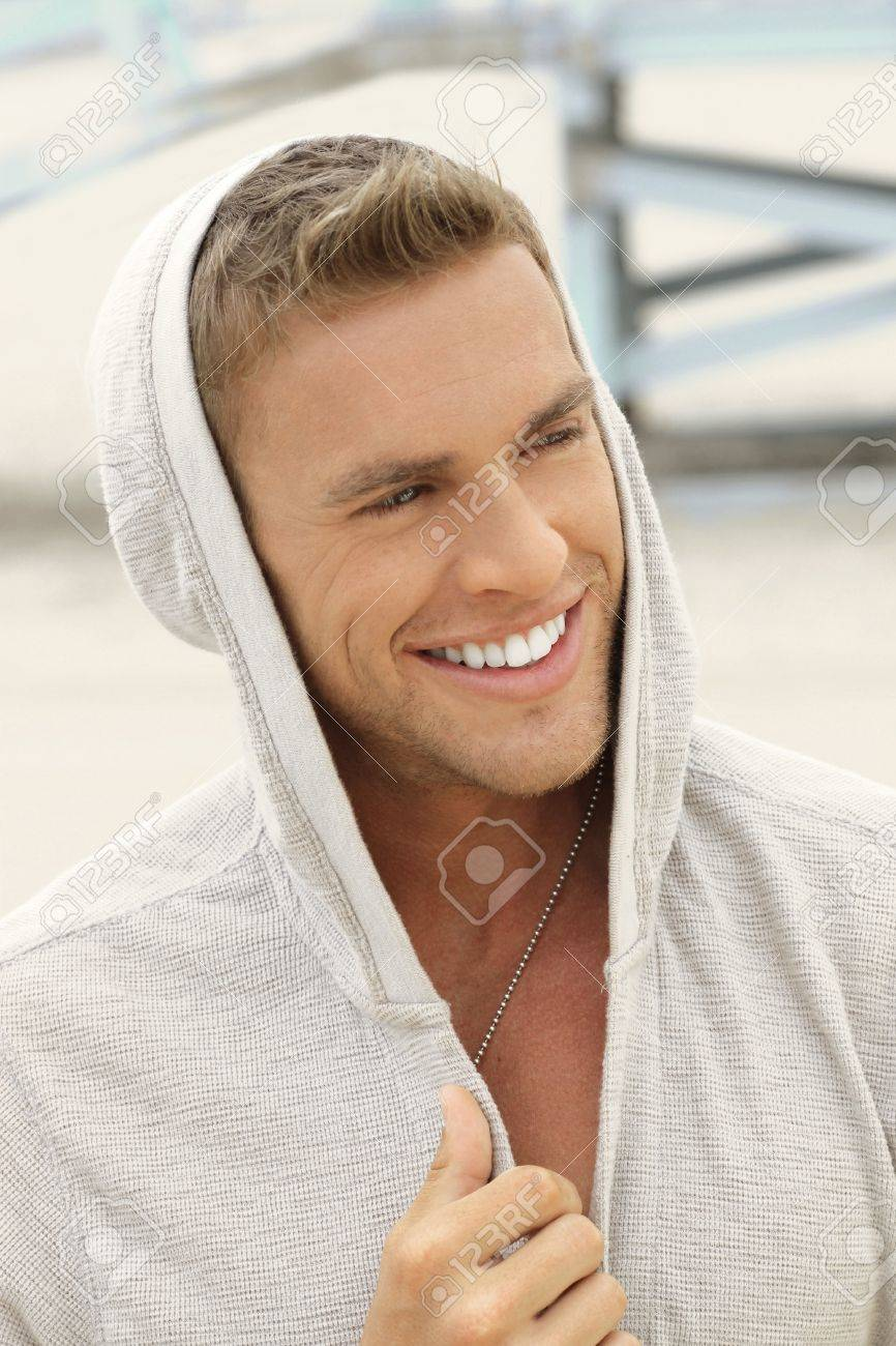 Happy smiling young man in casual clothing outside Stock Photo - 13929905