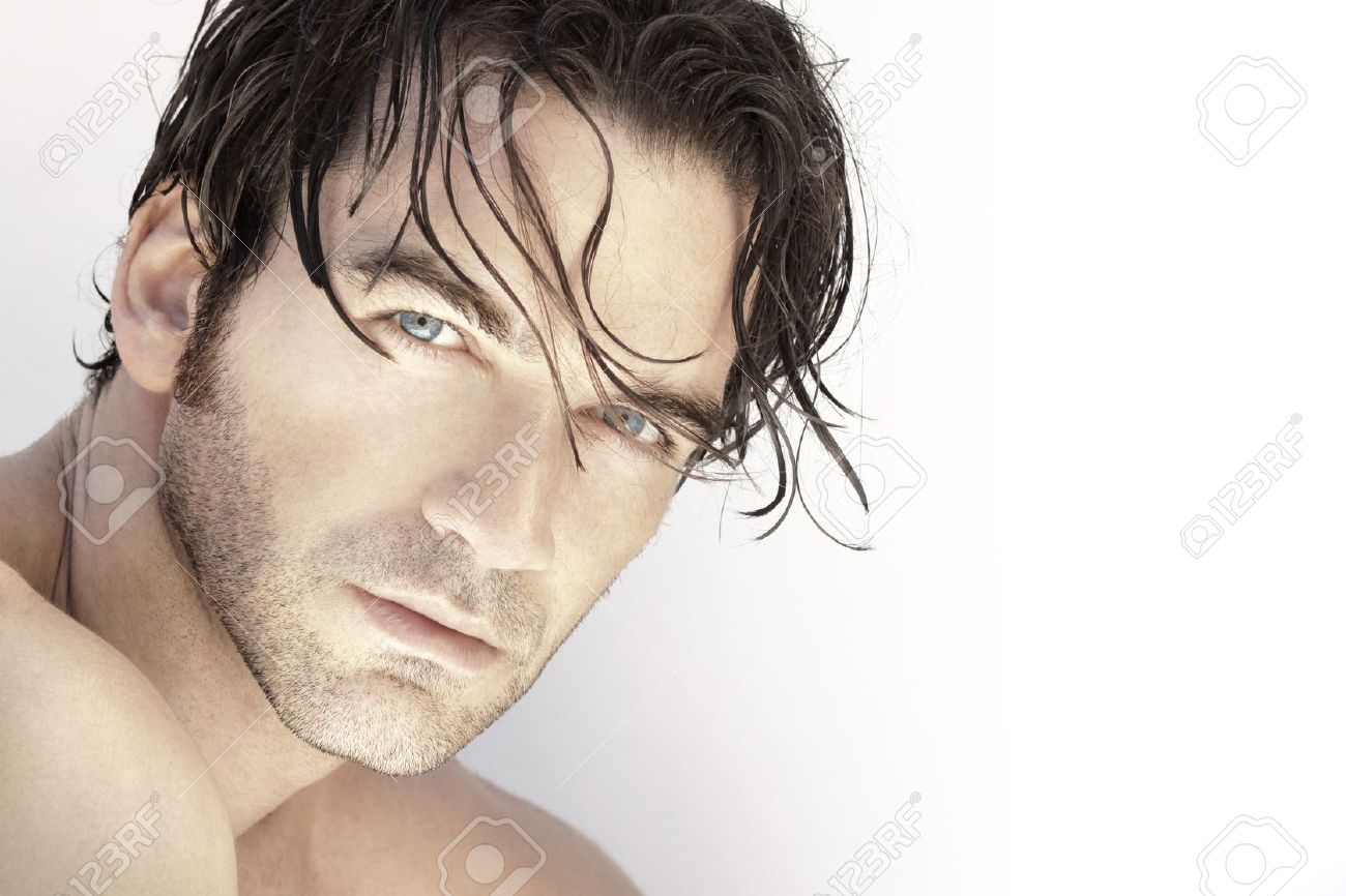 Close up portrait of a beautiful sexy male model face against white background Stock Photo - 14463065