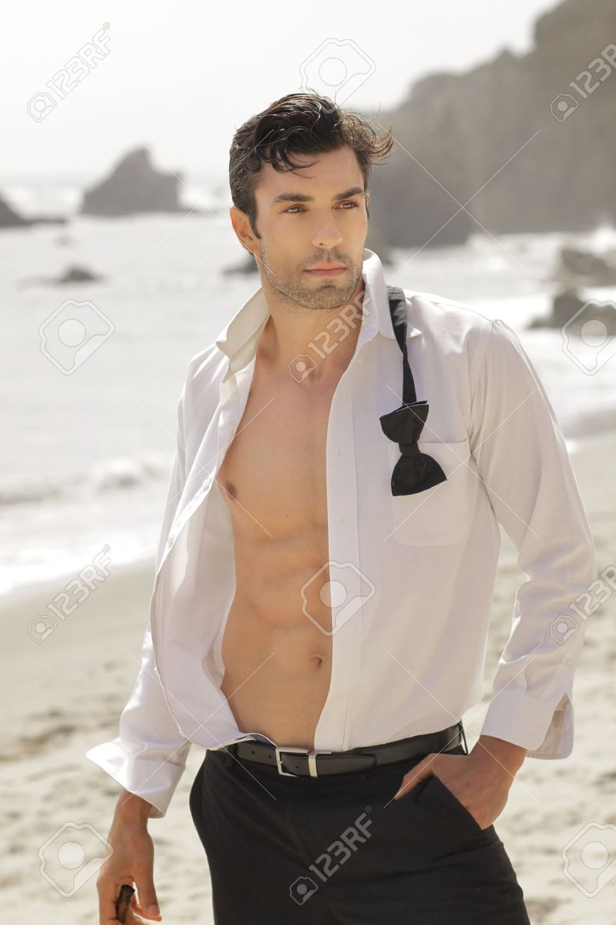 Great looking fit man in open white shirt formal wear outdoors with sexy body Stock Photo - 14463034