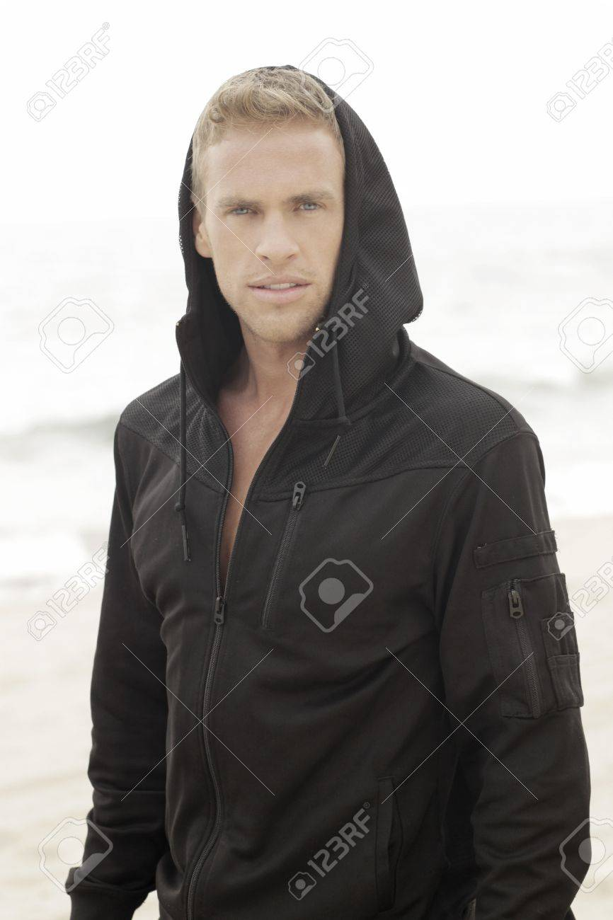 Young handsome man in black hooded active clothing Stock Photo - 14567344