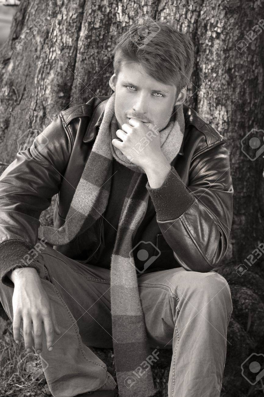 Classically dressed young male model outdoors in fall clothing with jacket and scarf Stock Photo - 15303623