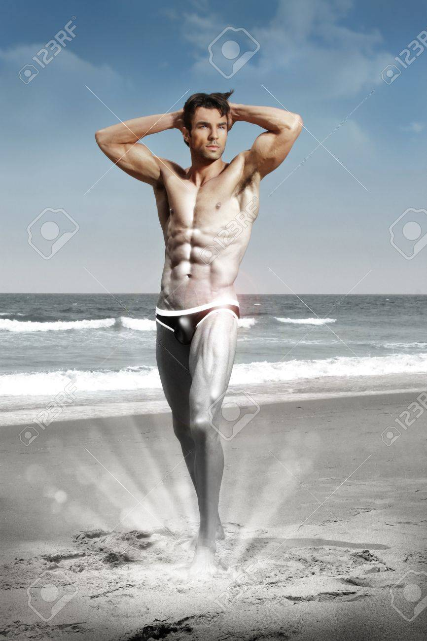 Stylized conceptual sexy portrait of a very muscular shirtless male model  in sensual pose transforming from silver black and white to color Stock Photo - 16333296