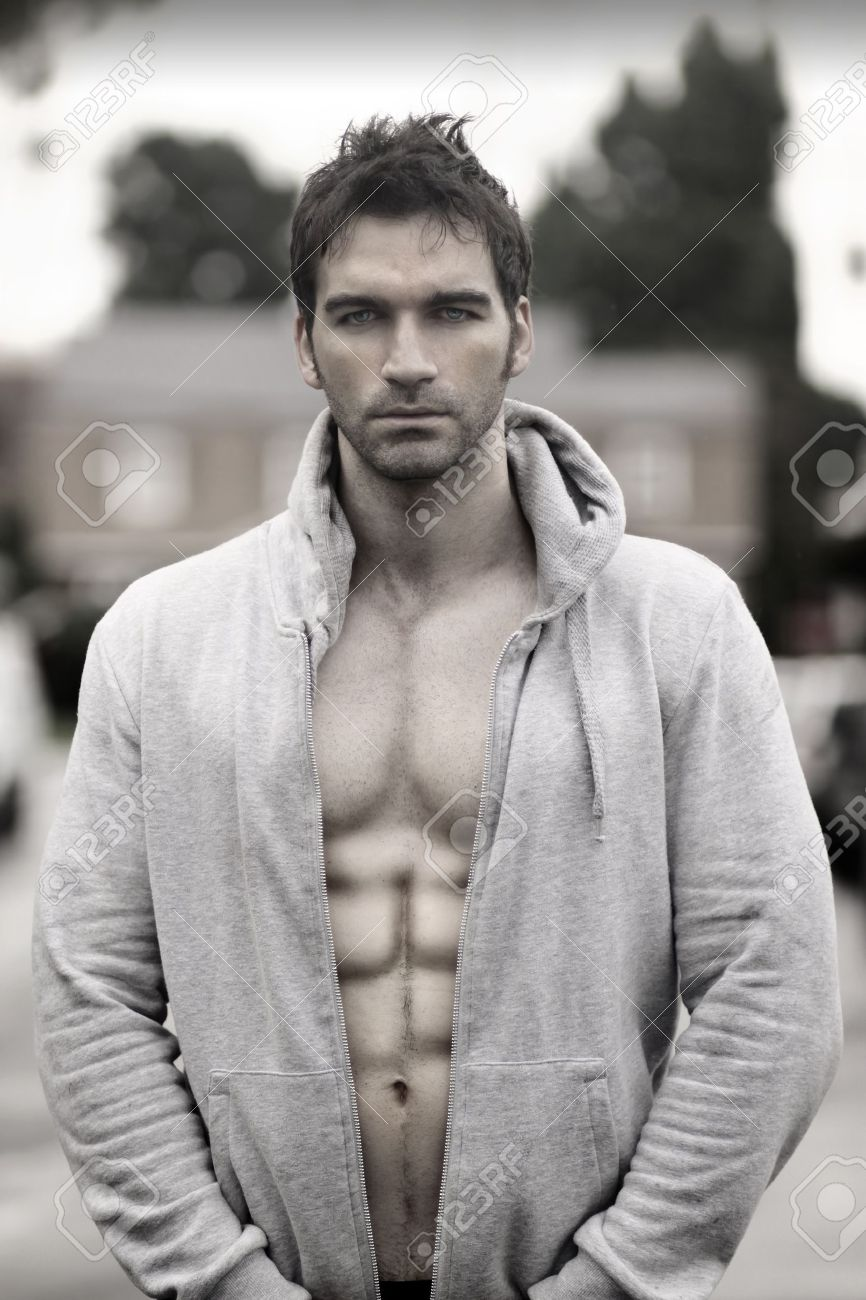 Sensual moody portrait of a great looking man in hooded jacket outdoors Stock Photo - 16490730